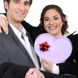Couple holding heart-shaped box — Stock Photo #9039288