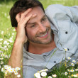 Happy man laid in a field — Stock Photo #9039979