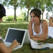Teenage couple relaxing in the park — Stock Photo