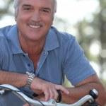 Man with push bike — Stock Photo #9040884