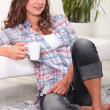 Woman relaxing with a hot drink — Stock Photo #9041491