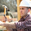 Handyman hitting a nail with a hammer — Stock Photo