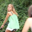 Two teenage girls on bike ride — Stock Photo
