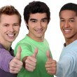 A group of young men giving the thumb's up — Stock Photo #9042589