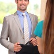 Businessman returning home to his wife — Stock Photo #9042734