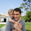 Stock Photo: Father giving little piggy-back