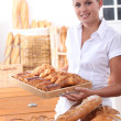 Young woman working in a bakery - Foto de Stock