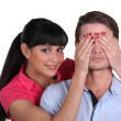 Stock Photo: Womcovering man's eyes