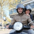 Stock Photo: Couple of young smiling bikers