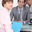 Stock Photo: Teenager handing work in to male teacher