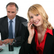 Boss and young female assistant — Stock Photo