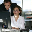 Business couple at a computer — Stock Photo #9043676