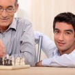 Father and son playing chess — Stock Photo