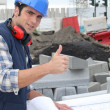 Stock Photo: Construction worker giving thumbs up