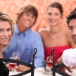 Friends dining — Stockfoto #9044321