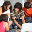 Royalty-Free Stock Photo: Teenagers looking at a computer screen