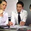 Businesspeople discussing performance - Stock Photo