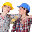 Two female carpenters chatting - Stockfoto