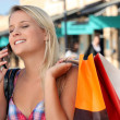 Girl on the phone after shopping frenzy — Stock Photo #9045669