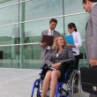 Employee in wheelchair — Stock Photo #9046020