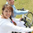 Young couple riding bikes — Stock Photo #9047094