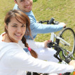 Young couple riding bikes — Stock Photo