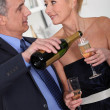 Mature couple drinking champagne — Stock Photo