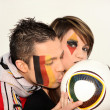 Couple of German football fans - Stock Photo