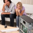 Couple sat in front of broken computer — Stock Photo
