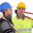 Two builders with tools — Stock Photo