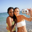 Two female friends taking self-portrait at the beach — Stock Photo