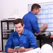 Two electricians working in back office — Stock Photo