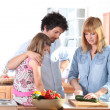Young family in the kitchen — Stock Photo
