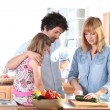 Young family in the kitchen — Stock Photo #9049360