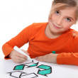 Girl colouring recycling sign — Stock Photo #9049605