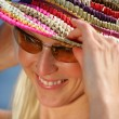 Royalty-Free Stock Photo: Woman wearing sunglasses and summer hat