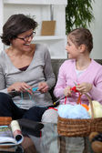 Grandmother knitting with her granddaughter — Stock Photo