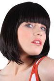 Close-up portrait of glamorous blue-eyed brunette with fringe — Stock Photo