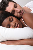 Mixed-race couple asleep — Stock Photo