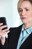 Female executive with mobile phone — Stock Photo