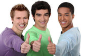 A group of young men giving the thumb's up — Stock Photo
