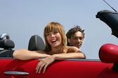 Woman riding in a convertible — Stock Photo