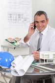 An architect talking on the phone — Stock Photo