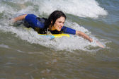 Woman bodyboarding — Stock Photo