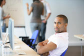 Man sitting back in an office — Stock Photo