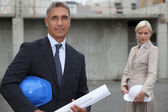 Couple of executive in a construction site — Stock Photo