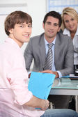 Teenager handing work in to male teacher — Stockfoto