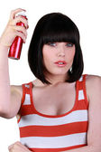 Woman using hairspray — Stock Photo