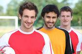 Grabbarna på fotbollsplan — Stockfoto