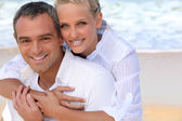 Portrait of a beautiful couple at the beach — Stock Photo